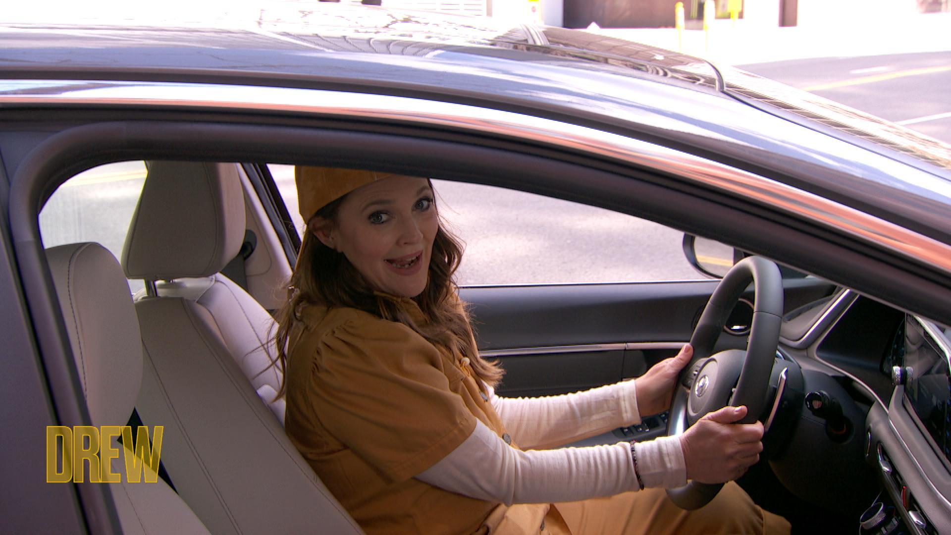 Drew in a car