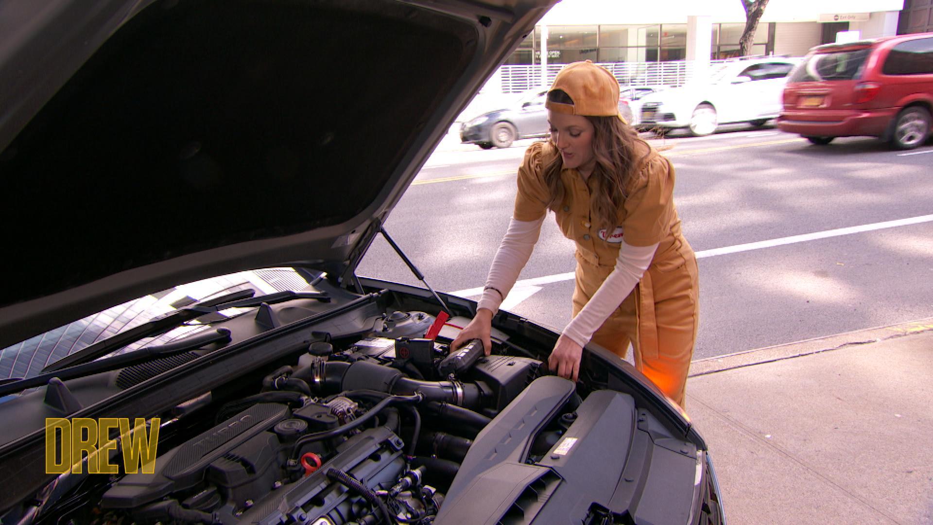 Drew checking car