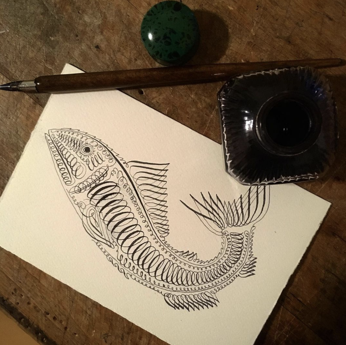 Calligraphy pen drawing of fish