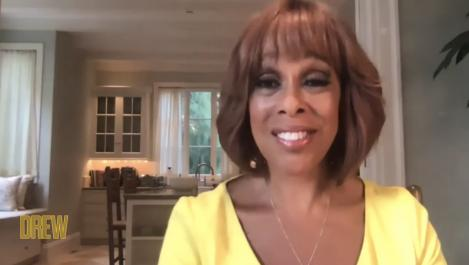 Gayle King sits in her home