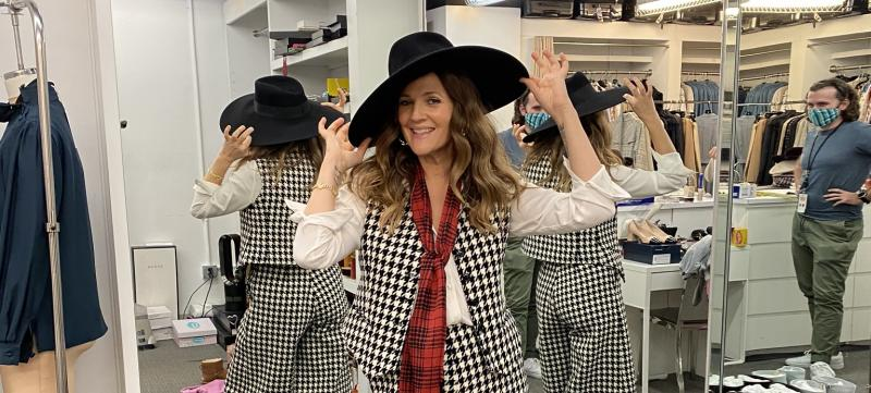 Drew in her dressing room holding a hat