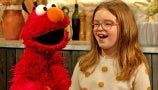 8-Year-Old Emmy Eaton Asks Elmo Questions Like What's His Favorite Food